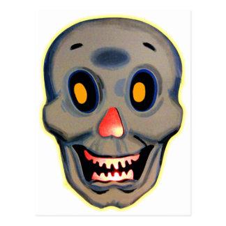 Cráneo feliz de Halloween del kitsch retro del Postal
