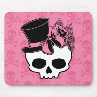 Cráneo femenino con el gorra y el arco rosado alfombrilla de raton