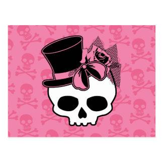 Cráneo femenino con el gorra y el arco rosado postal
