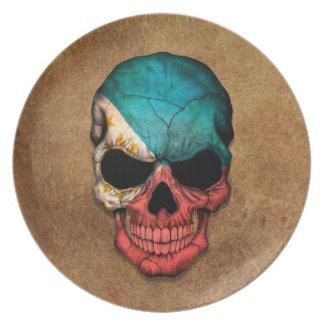 Cráneo filipino envejecido y llevado de la bandera plato de cena