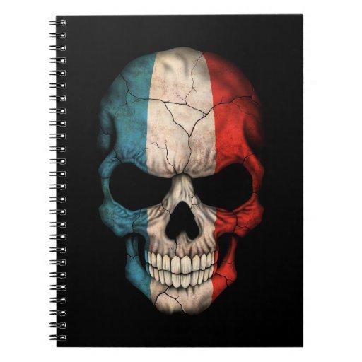Cráneo francés de la bandera en negro libros de apuntes con espiral