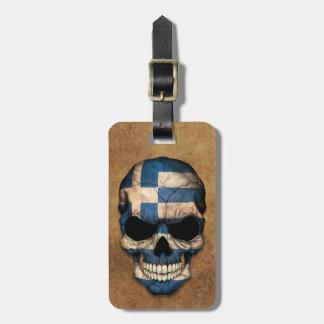 Cráneo griego envejecido y llevado de la bandera etiquetas para maletas