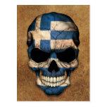 Cráneo griego envejecido y llevado de la bandera tarjetas postales