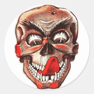 Cráneo hambriento de los monstruos retros del pegatina redonda