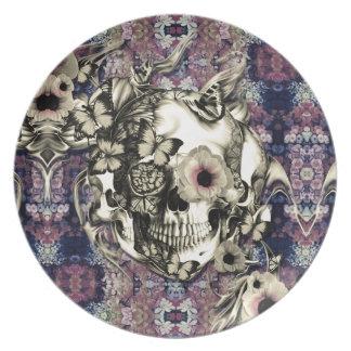 Cráneo hecho de amapolas y de mariposas plato para fiesta