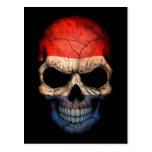 Cráneo holandés de la bandera en negro postales