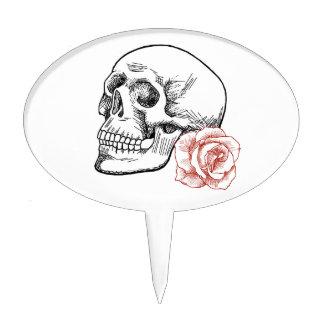 Cráneo humano con el dibujo lineal del rosa rojo figura de tarta