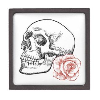 Cráneo humano con el dibujo lineal del rosa rojo cajas de regalo de calidad