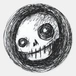 Cráneo incompleto pegatina redonda