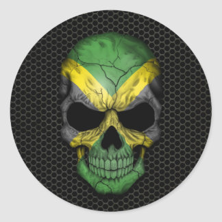 Cráneo jamaicano de la bandera en el gráfico de etiqueta redonda