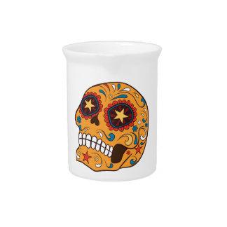 Cráneo mexicano anaranjado del azúcar con los ojos jarrones