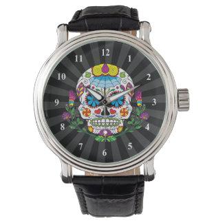 Cráneo mexicano coloreado del azúcar del tatuaje reloj