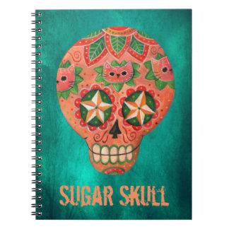 Cráneo mexicano rojo del azúcar libros de apuntes con espiral