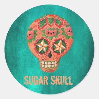 Cráneo mexicano rojo del azúcar pegatina redonda