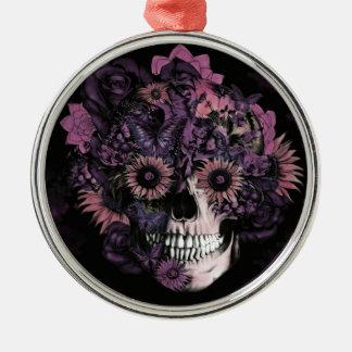 Cráneo púrpura del ohmio con las salpicaduras de l adorno de navidad