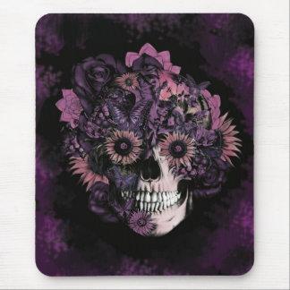 Cráneo púrpura del ohmio con las salpicaduras del  mouse pad