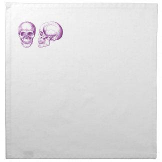 Cráneo púrpura del ser humano de la parte servilleta de papel