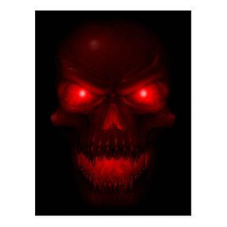 Cráneo que brilla intensamente rojo postal