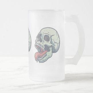 Cráneo que pega la lengua hacia fuera tazas de café