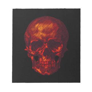 Cráneo rojo bloc de papel