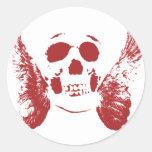 Cráneo rojo pegatina redonda