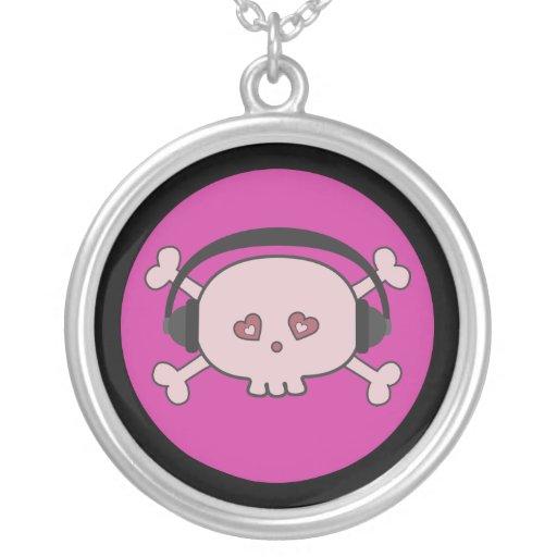 Cráneo rosado lindo DJ del dibujo animado con los  Joyerías