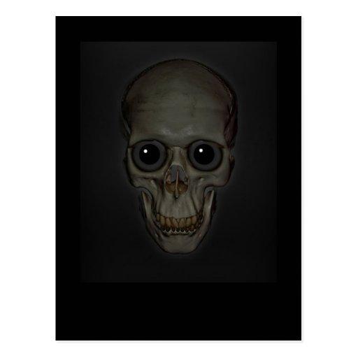 Cráneo sonriente con los ojos tarjetas postales