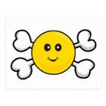 cráneo sonriente y bandera pirata de la cara tarjetas postales