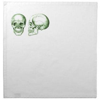 Cráneo verde del ser humano de la parte delantera servilletas