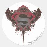 Cráneo y alas del logotipo del superhombre etiqueta redonda