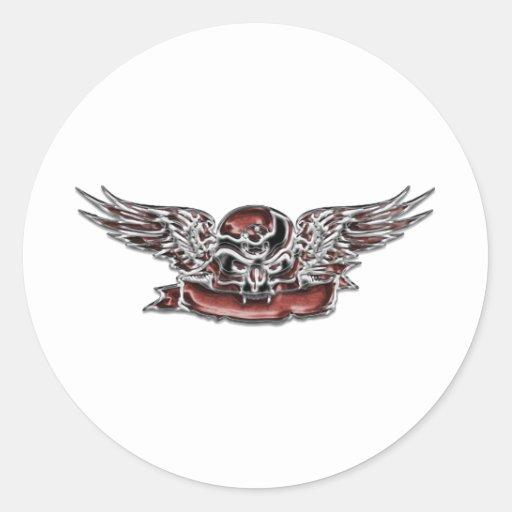 Cráneo y alas pegatina redonda
