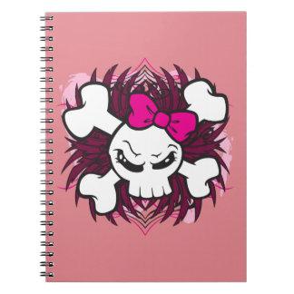 Cráneo y bandera pirata con el arco rosado más cuaderno