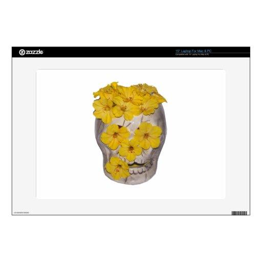 Cráneo y flores amarillas skins para portátiles