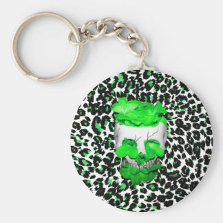 Cráneo y flores verdes en puntos del leopardo llavero