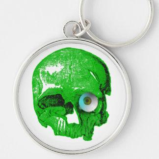 Cráneo y Globo del ojo-Verde Llavero Redondo Plateado