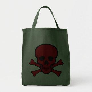 Cráneo y la bolsa de asas rojos de la bandera pira