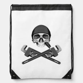 Cráneo y llaves del fontanero mochilas
