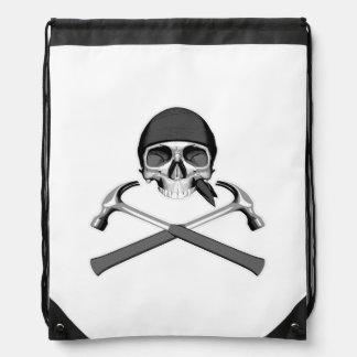 Cráneo y martillos mochila