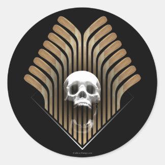 Cráneo y palillos pegatina redonda