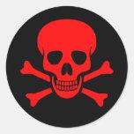 Cráneo y pegatina rojos de la bandera pirata