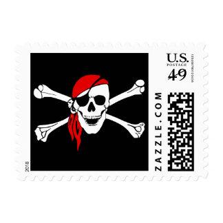 Cráneo y pirata de los huesos de la cruz estampillas