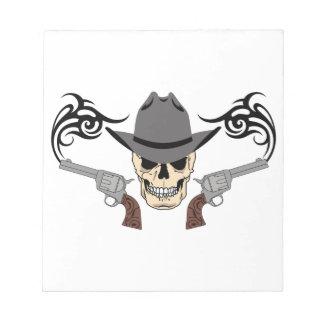 Cráneo y pistolas del vaquero bloc de notas