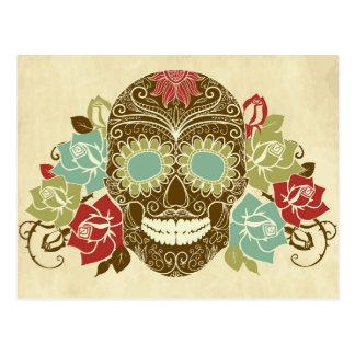 Cráneo y rosas, día colorido de la tarjeta muerta postales