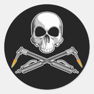 Cráneo y sopletes pegatina redonda