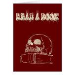 Cráneo y un libro felicitacion