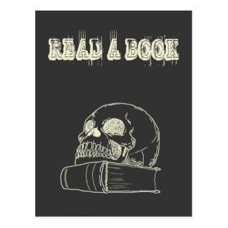 Cráneo y un libro postales