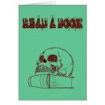 Cráneo y un libro tarjetas