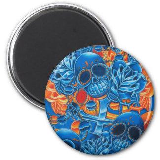 Cráneos azules y anaranjados imán redondo 5 cm
