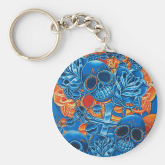 Cráneos azules y anaranjados llavero redondo tipo pin