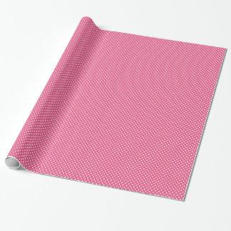 Cráneos blancos en el papel de embalaje rosado papel de regalo